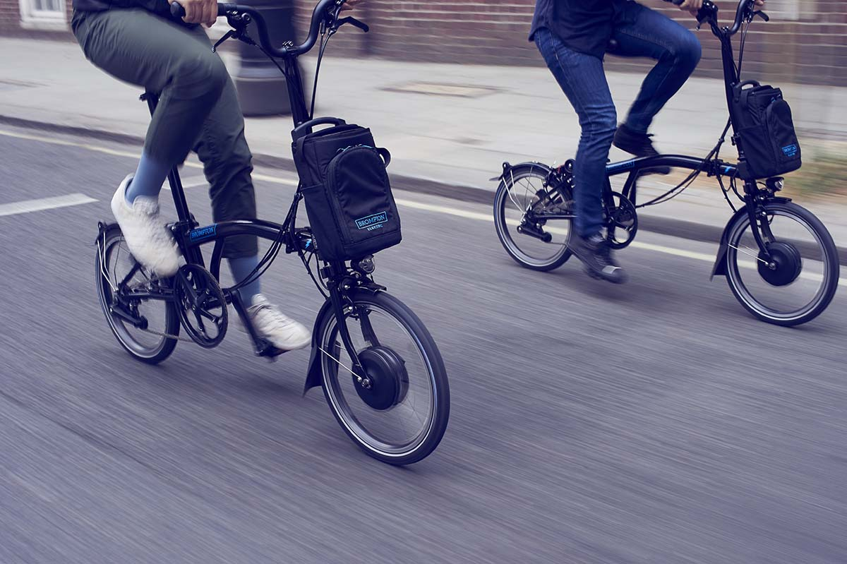 Two Brompton electric bikes being ridden